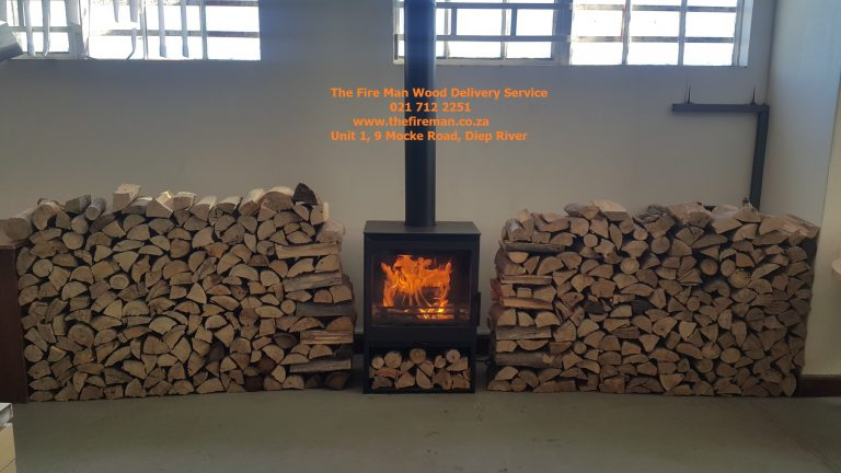 24 bags stacked next to fire place with name